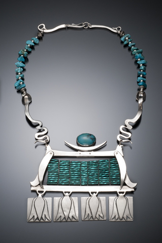 My Egyptian Dream, The design stretches from bird to bird, and at the bottom of the frame where the water lilies hang beneath turquoise gemstones and glass beads..